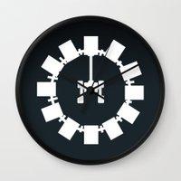 interstellar Wall Clocks featuring Interstellar by Duck Cartel