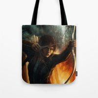 katniss Tote Bags featuring Katniss Everdeen by Emily Doyle