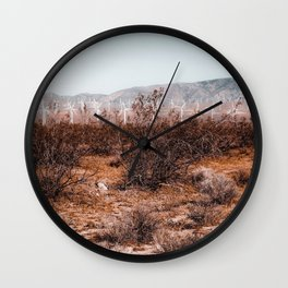 Desert and wind turbine with mountain view at Kern County California USA Wall Clock