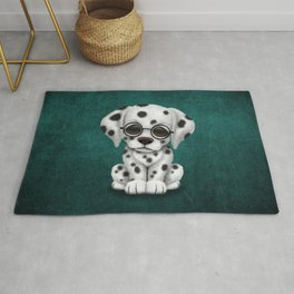 Dalmatian Puppy Wearing Reading Glasses on Blue Rug