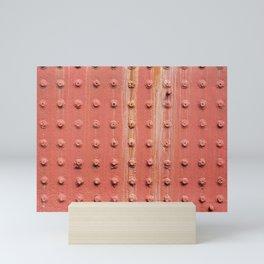 Riveted metal wall surface Mini Art Print