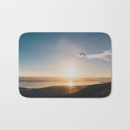 Sunset Paragliding over beach and mountains Bath Mat