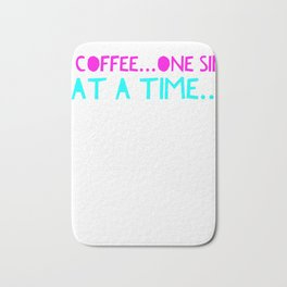 Coffee one sip at a time Bath Mat