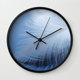 Feather in the clouds Wall Clock
