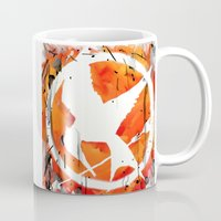 mockingjay Mugs featuring The Mockingjay by Trinity Bennett