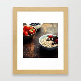 Bowls with cereals and fresh berries on wooden table Framed Art Print