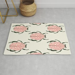 pink beetle insect Rug