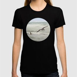 Seagulls flying over rough sea T-shirt
