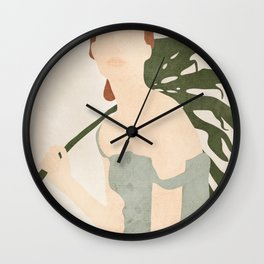 Holding the Monstera Leaf Wall Clock