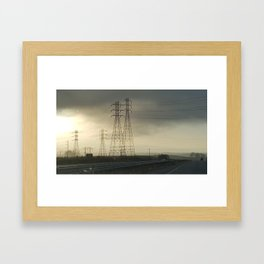 Phone towers in the clouds Framed Art Print