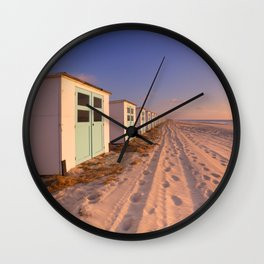 Row of beach huts at sunset, Texel island, The Netherlands Wall Clock