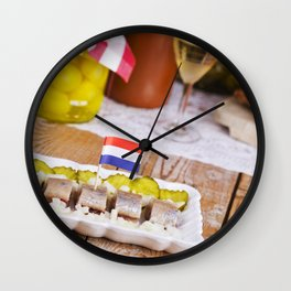 I - Dutch herring ('haring') with onions and pickles on rustic table Wall Clock