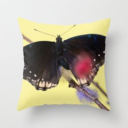 Tropical butterfly sitting on the colored bush over yellow background Throw Pillow
