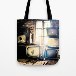 Old televisions in a dusty attic Tote Bag