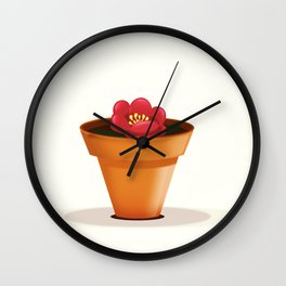 Pretty red flower in a pot Wall Clock