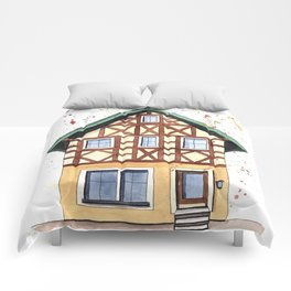 Half-timbered whimsical house in watercolors Comforters