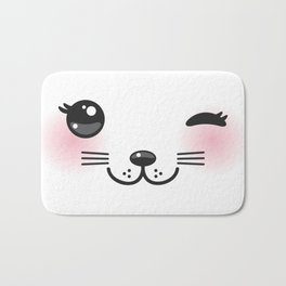 Kawaii funny cat with pink cheeks and winking eyes on white background Bath Mat
