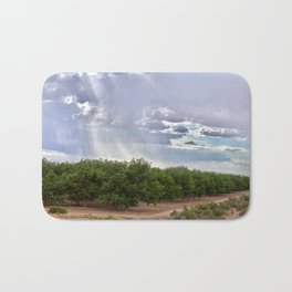 Storm Over a Tree Grove Bath Mat