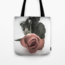 Rose resting in the snow Tote Bag