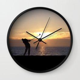 Playing Golf At Sunset Wall Clock