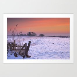 Typical Dutch landscape with windmill in winter at sunrise Art Print