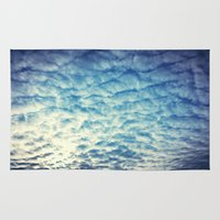 racing Area & Throw Rugs featuring Racing Clouds by Luci Dreams