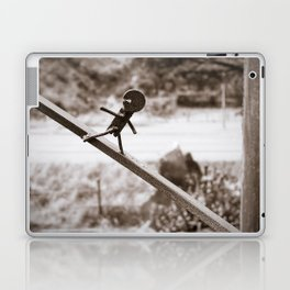 Metal Figure Walking Down Laptop & iPad Skin
