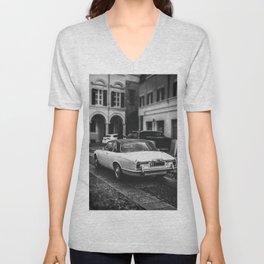 vintage jaguar car in vertical black and white background Unisex V-Neck