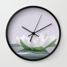 white lotus flower in a green bowl; wisteria white background Wall Clock
