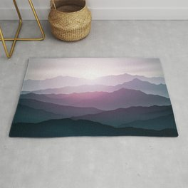 dark blue mountain landscape with fog and a sunrise and sunset Rug