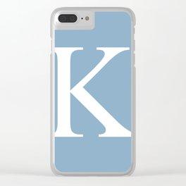 Letter K sign on placid blue background Clear iPhone Case