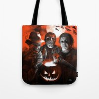 michael myers Tote Bags featuring Freddy Krueger Jason Voorhees Michael Myers Super Villians Holiday by Scott Jackson Monsterman Graphic