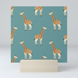 Giraffes on blue Mini Art Print