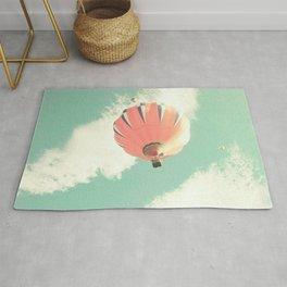 Nursery coral hot air balloon over mint sky Rug