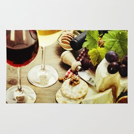 Wine, grape and cheese on wooden background Rug