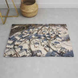 mountain village from the sky Rug