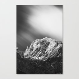Misty clouds over the mountains in black and white Canvas Print