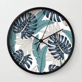 Original seamless tropical pattern with bright plants and leaves on a light background. Beautiful print with hand drawn exotic plants. Trendy summer Hawaii print. Wall Clock