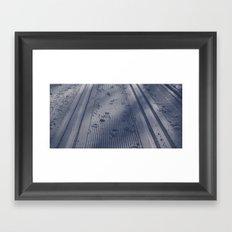 Snow tracks Framed Art Print