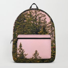 Tall trees against pink sky Backpack