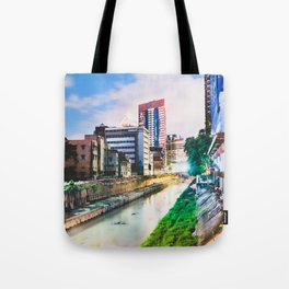 On going rapid urbanization leads to river pollution. Tote Bag