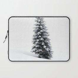 Pine tree in snow blizzard in winter scenery Laptop Sleeve