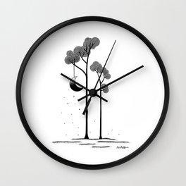The moon trees Wall Clock