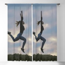 Sporty young woman jumping outdoor morning clouds background, Athlete Woman jump beautiful sunrise m Blackout Curtain