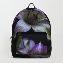 Floral bouquet. Purple and white flowers. Backpack