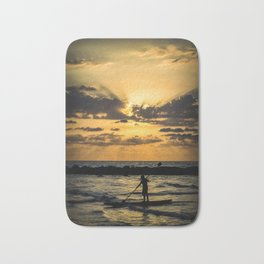 Rafting into the sunset Bath Mat