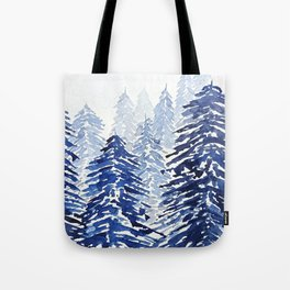 A snowy pine forest Tote Bag