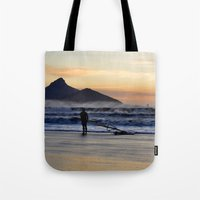 south africa Tote Bags featuring Sunset Beach - South Africa by The 3rd Eye