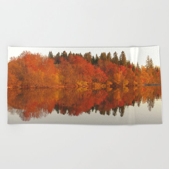 Colorful autumn trees reflection in the lake Beach Towel