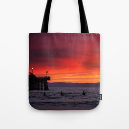 Surfers watching Sunset Tote Bag